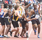 The Gazette Largo High School's Rick Allen far right hands the baton off to team mate Ben McKinzie, second to right, as they run the 4x400 meter on Saturday morning during the Penn Relays held at the University of Pennsylvania in Philadelphia on Saturday. Largo placed fourth in their heat with a time of 3:24.14