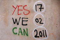 Graffiti on a wall reading 'Yes We Can - 17-02-2011'. On 17 February 2011 Libya saw the beginnings of a revolution against the 41 year regime of Col Muammar Gaddafi.