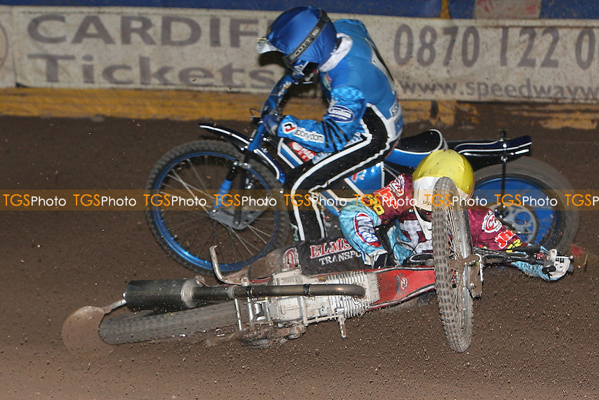 Heat 4: Dawid Stachyra (blue) of Ipswich crashes out with Stuart Robson (yellow) - Ipswich Witches vs Lakeside Hammers - Speedway Challenge Match First Leg at Foxhall Stadium, Ipswich, Suffolk - 19/03/09 - MANDATORY CREDIT: Gavin Ellis/TGSPHOTO - Self billing applies where appropriate - 0845 094 6026 - contact@tgsphoto.co.uk - NO UNPAID USE.