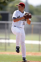 July 11, 2009:  Pitcher Spencer Hylander (14) of the GCL Astros delivers a pitch during a game at Osceola County Complex in Kissimmee, FL.  The GCL Astros are the Gulf Coast Rookie League affiliate of the Houston Astros.  Photo By Mike Janes/Four Seam Images