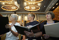"Southern Arizona Women's Chorus members Mary Walker (MARY WALKER), left, Dee Ponzio (DEE PONZIO) and Anne Magee (ANNE MAGEE) sing during a rehearsal at the Grand Hyatt in New York, NY on Friday, June 23, 2006.  The Chorus performed Brusa's ""Missa pro defunctis"" and Beach's ""The Rose of Avontown, Op. 30"" at Carnegie Hall on Sunday night."