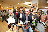 NO REPRO FEE.8/10/2011. Eason, Ireland's leading retailer of books, stationery, magazines and lots more, hosted a book signing by Jockey, Paul Carberry.  Pictured at Eason, O'Connell Street, Dublin are fans and Paul Carberry who signed copies of his new autobiography One Hell of a Ride. Follow Eason on Twitter - @easons For further information, please contact: Aoife McDonald WHPR 087 4100777 . Picture James Horan/Collins Photos
