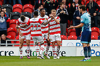 Tommy Rowe of Doncaster Rovers (left) celebrates after he scores his team's first goal of the game to make it 1-1 during the Sky Bet League 2 match between Doncaster Rovers and Wycombe Wanderers at the Keepmoat Stadium, Doncaster, England on 29 October 2016. Photo by David Horn.