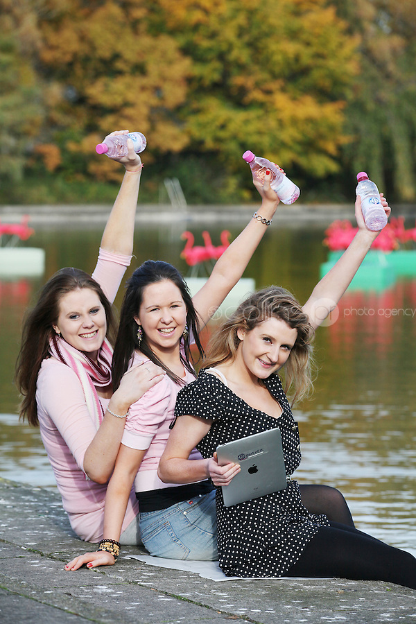 "NO Repro Fee.27/10/2010.  Ballygowan Pink's B Part Of It campaign in support of Breast Cancer Awareness Month. Hundreds of UCD students got behind Ballygowan Pink's B Part Of It campaign in support of Breast Cancer Awareness Month. Pictured are Sinead McAuliffe from Dublin, Regina Brady from Longford and Niamh Richardson from Dublin getting acquainted with some unusual pink guests on campus. As part of Ballgowan Pink's B Part Of It campaign, raising much need funded for the Marie Keating Foundation, over 100 ""pink flamingos"" descended upon UCD lake this week to mark Breast Cancer Awareness Month. Picture James Horan/Collins Photos"