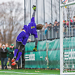 15 November 2015: University of Vermont Catamount Goalkeeper Greg Walton, a Junior from Brunswick, Maine, tips one to clear the crossbar during game action against the Binghamton University Bearcats at Virtue Field in Burlington, Vermont. The Catamounts shut out the Bearcats 1-0 in the America East Championship Game. Mandatory Credit: Ed Wolfstein Photo *** RAW (NEF) Image File Available ***