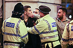 © Joel Goodman - 07973 332324 . No syndication permitted . 01/01/2014 . Manchester , UK . Police have words with a man who has become aggressive . Revellers see in the New Year in Manchester today (January 1st 2014) as police report that officers are at full stretch responding to calls . Photo credit : Joel Goodman