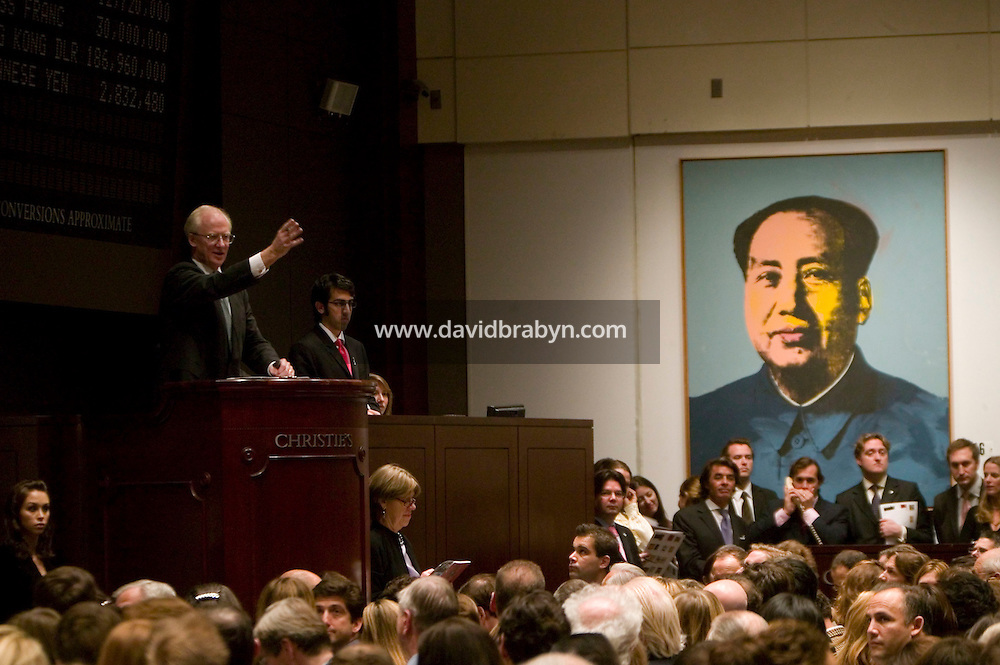 14 November 2006 - New York City, NY - Principal auctioneer Christopher Burge (L, podium) takes bids during a sale of Post-War and Contemporary Art at the Christie?s auction house in New York City, USA, 14 November 2006. The sale reached a total of $239,704,000.