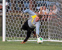 Winthrop University Eagles vs the Brevard College Tornados at Eagle's Field in Rock Hill, SC.  The Eagles beat the Tornados 6-0.  Heath Turner (0) dives in an effort to stop a penalty kick struck for Winthrop's first goal by Adam Brundle (12).