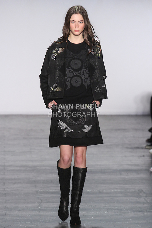 "Model Laura walks runway in a black multi patchwork jacket with black patchwork sweater and black multi patchwork skirt, from the Vivienne Tam Fall Winter 2016 ""Cultural Dreamland The New Silk Road"" collection, presented at NYFW: The Shows Fall 2016, during New York Fashion Week Fall 2016."