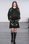 """Model Laura walks runway in a black multi patchwork jacket with black patchwork sweater and black multi patchwork skirt, from the Vivienne Tam Fall Winter 2016 """"Cultural Dreamland The New Silk Road"""" collection, presented at NYFW: The Shows Fall 2016, during New York Fashion Week Fall 2016."""