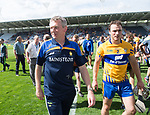 A happy Donal Moloney, Clare joint manager leaves the field with Patrick O Connor, captain, following their All-Ireland quarter final against Wexford at Pairc Ui Chaoimh. Photograph by John Kelly.