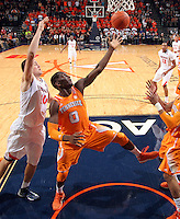 Tennessee center Yemi Makanjuola (0) reaches for the loose ball with Virginia forward/center Mike Tobey (10) during the game Wednesday in Charlottesville, VA. Virginia defeated Tennessee 46-38.