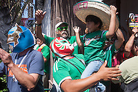 Los Angeles, CA -  Monday, June 23, 2014: Mexico fans celebrate their victory over Croatia in a first round match at a public viewing at Plaza Mexico.