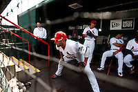 Alex Castellanos (18) of the Springfield Cardinals stretches in the dugout prior to a game against the Midland RockHounds on April 18, 2011 at Hammons Field in Springfield, Missouri.  Photo By David Welker/Four Seam Images