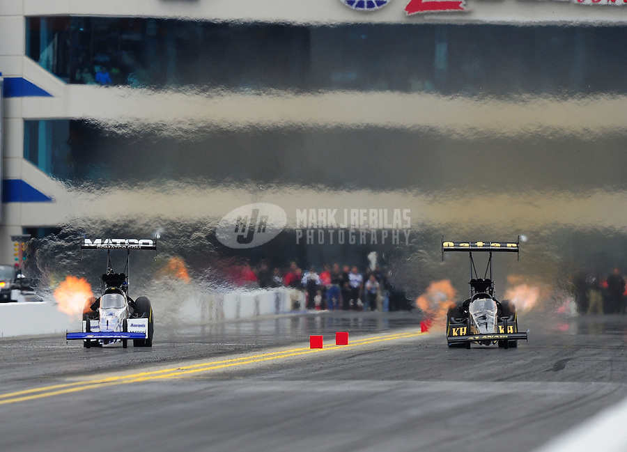 Sept. 17, 2011; Concord, NC, USA: NHRA top fuel dragster driver Antron Brown (left) races alongside Del Worsham during qualifying for the O'Reilly Auto Parts Nationals at zMax Dragway. Mandatory Credit: Mark J. Rebilas-