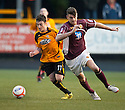 Alloa's Kevin Cawley and Stenny's Scott Buist challenge for the ball.