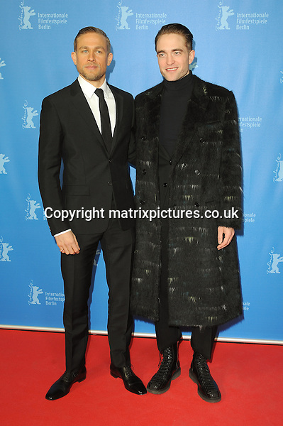 NON EXCLUSIVE PICTURE: PAUL TREADWAY / MATRIXPICTURES.CO.UK<br /> PLEASE CREDIT ALL USES<br /> <br /> WORLD RIGHTS<br /> <br /> English actor Charlie Hunnam and English actor Robert Pattinson attend The Lost City Of Z screening during the 67th Berlinale International Film Festival Berlin at the Grand Hyatt Hotel in Berlin, Germany.<br /> <br /> FEBRUARY 14th 2017<br /> <br /> REF: PTY 17282