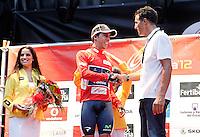 Miguel Indurain gives the  Red Malliot of La Vuelta Leader to Mivistar's Jonathan Castroviejo after Special Crono Stage.August 17,2012. (ALTERPHOTOS/Alfaqui/Acero) /NortePhoto.com<br /> <br /> **SOLO*VENTA*EN*MEXICO**<br /> **CREDITO*OBLIGATORIO** <br /> *No*Venta*A*Terceros*<br /> *No*Sale*So*third*<br /> *** No Se Permite Hacer Archivo**<br /> *No*Sale*So*third*