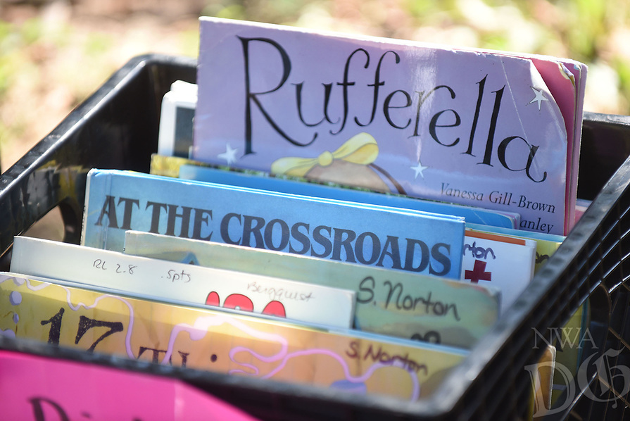 NWA Democrat-Gazette/FLIP PUTTHOFF <br />Books for adults and children are available    Tuesday July 11 2017     for summer reading.