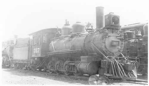 3/4 engineer's-side view of D&amp;RGW #317 stored in Alamosa.<br /> D&amp;RGW  Alamosa, CO  Taken by Nixon, R. V. - 5/11/1933
