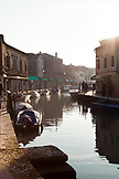 ITALY, Venice. A view of a canal, homes and stores on the Island of Murano.
