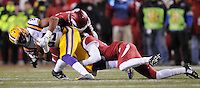 NWA Media/ J.T. Wampler -  LSU's Travin Dural gets tackled by a pair of Arkansas defenders Saturday Nov. 15, 2014 at Donald W. Reynolds Razorback Stadium.