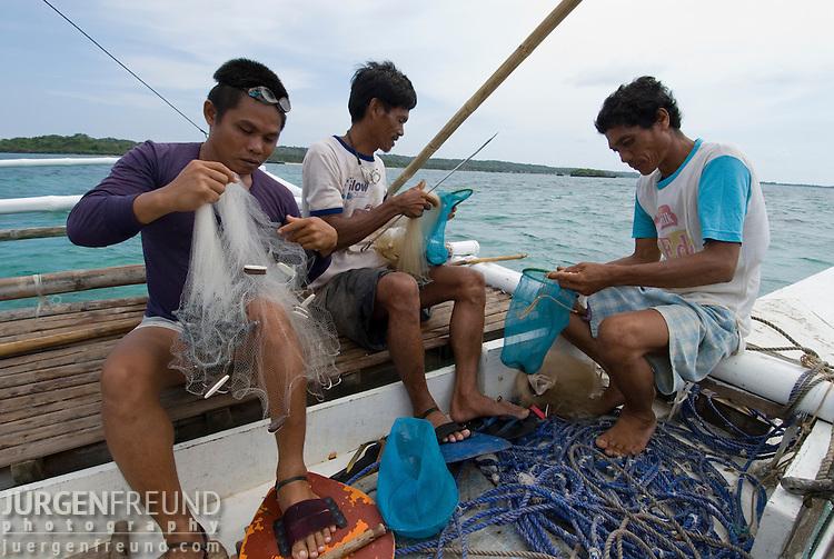 Aquarium fishermen.Cagayancillo, Palawan, Philippines