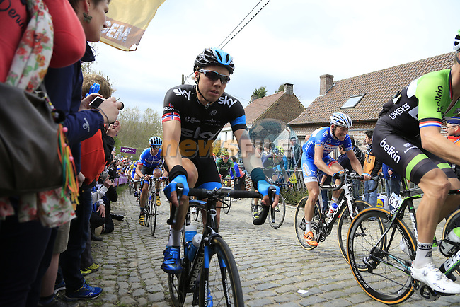 The peleton, including Edvald Boasson Hagen (NOR) Team Sky, climb the Molenberg during the 2014 Tour of Flanders, Belgium.<br /> Picture: Eoin Clarke www.newsfile.ie