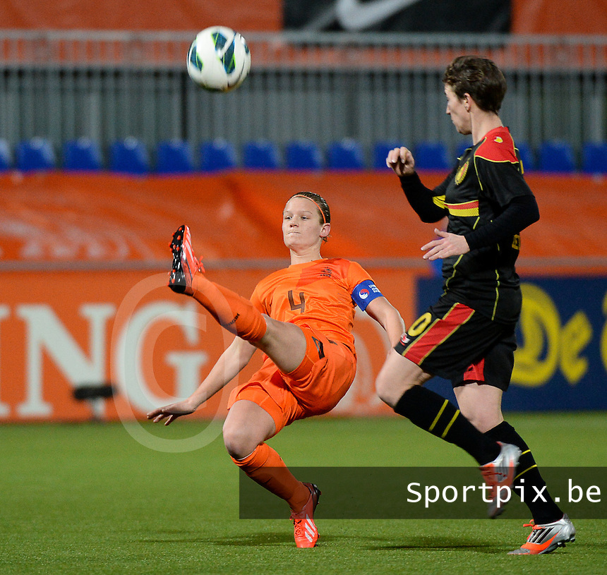 20140212 - ZWOLLE , THE NETHERLANDS : Dutch Mandy van den Berg pictured with Belgian Aline Zeler (r) during the female soccer match between The Netherlands and Belgium , on the fifth matchday in group 5 of the UEFA qualifying round to the FIFA Women World Cup in Canada 2015 at Het Ijseldelta Stadion , Zwolle . Wednesday 12th February 2014 . PHOTO DAVID CATRY