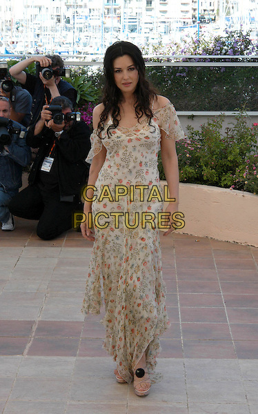 MONICA BELLUCCI.The Matrix: Reloaded Photocall.Cannes Film Festival 2003.www.capitalpictures.com.sales@capitalpictures.com.©Capital Pictures.floral print chiffon dress, floaty dress