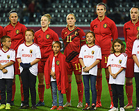 20191112 - LEUVEN , BELGIUM : Belgian Janice Cayman pictured giving away her jacket to help a cold children mascotte during the female soccer game between the Belgian Red Flames and Lithuania , the fourth womensoccer game for Belgium in the qualification for the European Championship round in group H for England 2021, Tuesday 12 th November 2019 at the King Power Stadion Den Dreef in Leuven , Belgium. PHOTO SPORTPIX.BE | DAVID CATRY