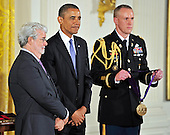 George Lucas, left, listens as the citation is read as he waits to be presented the 2012 National Medal of Arts by United States President Barack Obama, center, during the presentation ceremony in the East Room of the White House in Washington, D.C. on Wednesday, July 10, 2013.<br /> Credit: Ron Sachs / CNP