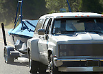 tightly cropped backlit shot of dually towing wake boat