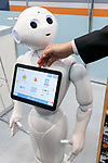 An exhibitor gives a demonstration of a payment application for convenience stores through humanoid robot Pepper during SoftBank Robot World 2017 on November 21, 2017, Tokyo, Japan. SoftBank Robotics organized SoftBank Robot World 2017 to introduce AI (Artificial Intelligence) and IoT (the Internet of Things) companies developing the latest technology for robots, including applications its humanoid robot Pepper in various business fields. The robot expo runs until November 22. (Photo by Rodrigo Reyes Marin/AFLO)
