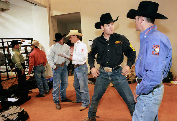 KISSIMMEE, FLORIDA : Cowboys discuss the upcoming competition at the PRCA (Professional Rodeo Cowboys Association ) Extreme Bulls rodeo event. The Xtreme Bulls Series was established in 2003 by the PRCA as a way to showcase rodeos most popular event bull riding. The Xtreme Bulls makes 10 stops in 8-cities, are televised and feature the best in bull riding from the bulls to the cowboys. Kissimmee, Florida. USA.