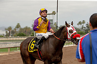 ARCADIA, CA  JUNE 16:Kent Desormeaux tosses his stick to his valet after he and Ollie's Candy win the Summertime Oaks (Grade ll) on June 16, 2018 at Santa Anita Park in Arcadia, CA. (Photo by Casey Phillips/Eclipse Sportswire/Getty Images)