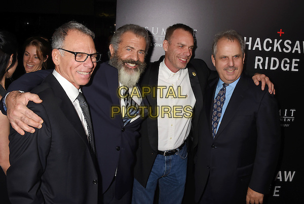 BEVERLY HILLS, CA - OCTOBER 24: (L-R) Producer David Permut, director Mel Gibson, producers Terry Benedict and Bill Mechanic attend the screening of Summit Entertainment's 'Hacksaw Ridge' at Samuel Goldwyn Theater on October 24, 2016 in Beverly Hills, California.<br /> CAP/ROT/TM<br /> &copy;TM/ROT/Capital Pictures
