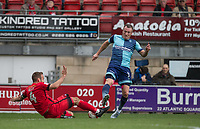 Liam Kelly of Leyton Orient tackles Garry Thompson of Wycombe Wanderers during the Sky Bet League 2 match between Leyton Orient and Wycombe Wanderers at the Matchroom Stadium, London, England on 1 April 2017. Photo by Andy Rowland.