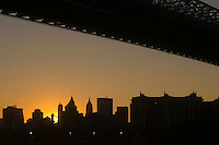 Williamsburg, Brooklyn - 19 October 2008 - Lower Manhattan, beneath the Williamsburg Bridge, viewed from the Domino Sugar Factory.