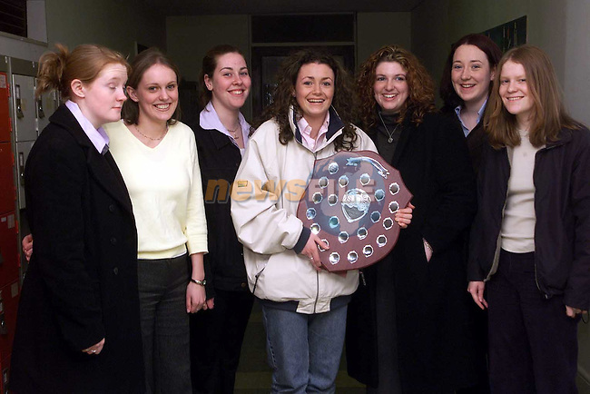 Rebecca Cooney (centre) who achieved the best results in the Leaving Cert 1999 pictured with fellow pupils Cliona Mulvihill, Danielle Victory, Rachel Murphy, Ruth Redmond, Louise Pentony and Angela Murphy at the awards day in the Sacred Heart school..Picture Paul Mohan Newsfile