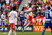 Erick (12) of FC Dallas goes up for a header with Tim Cahill (17) of the New York Red Bulls during a Major League Soccer (MLS) match at Red Bull Arena in Harrison, NJ, on September 22, 2013.
