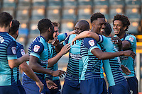 Teammates celebrate with goalscorer Adebayo Akinfenwa of Wycombe Wanderers during the Sky Bet League 2 match between Wycombe Wanderers and Accrington Stanley at Adams Park, High Wycombe, England on 16 August 2016. Photo by Andy Rowland.