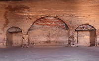 Apses in the main chamber of the Urn tomb, 1st century AD, Petra, Ma'an, Jordan. This Royal Nabatean tomb was probably built c. 70 AD for King Malichos II and was converted to a Christan church in 446-7 AD, when these apses were carved. It is also known as 'The Court' as it was used as a courthouse in Roman times. Petra was the capital and royal city of the Nabateans, Arabic desert nomads. Picture by Manuel Cohen