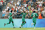 13 August 2008: Promise Isaac (NGA) (10) looks to hear it from the crowd following his first half goal.  The men's Olympic team of Nigeria defeated the men's Olympic soccer team of the United States 2-1 at Beijing Workers' Stadium in Beijing, China in a Group B round-robin match in the Men's Olympic Football competition.