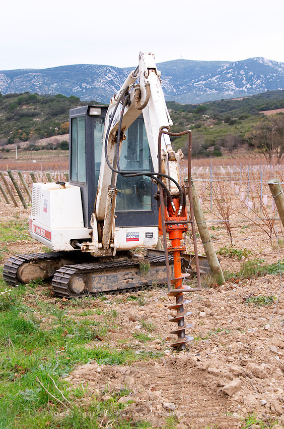 Chateau de Nouvelles. Fitou. Languedoc. Vineyard tractor machine with screw to makes holes in the ground to plant vines. The vineyard. France. Europe.