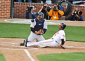Baltimore, MD - April 6, 2009 -- New York Yankees catcher Jorge Posada (20) tags out Baltimore Oriole third baseman Melvin Mora (6) as he attempted to score to end the fifth inning at Oriole Park at Camden Yards in Baltimore, MD on Monday, April 6, 2009..Credit: Ron Sachs / CNP.(RESTRICTION: NO New York or New Jersey Newspapers or newspapers within a 75 mile radius of New York City)