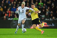 Sam Surridge of Swansea City battles with Shaun Hutchinson of Millwall during the Sky Bet Championship match between Swansea City and Millwall at the Liberty Stadium in Swansea, Wales, UK. Saturday 23rd November 2019