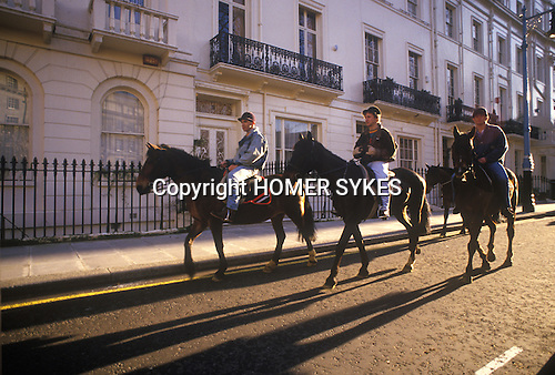 Horse riding through Knightsbridge on way to Hyde Park, London 1980s. UK