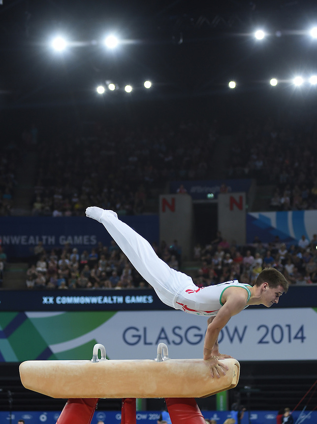 Wales' Clinton Purnell competes in the pommel horse<br /> <br /> Gymnastics artistic - Team final &amp; Individual Qualification <br /> <br /> Photographer Chris Vaughan/CameraSport<br /> <br /> 20th Commonwealth Games - Day 5 - Monday 28th July 2014 - Gymnastics artistic - The SSE Hydro - Glasgow - UK<br /> <br /> &copy; CameraSport - 43 Linden Ave. Countesthorpe. Leicester. England. LE8 5PG - Tel: +44 (0) 116 277 4147 - admin@camerasport.com - www.camerasport.com