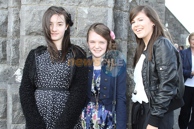 Aisling Eaton, Niamh Markey and Emma Markey at Tullyallen NS. Confirmation...(Photo credit should read Jenny Matthews www.newsfile.ie)....This Picture has been sent you under the conditions enclosed by:.Newsfile Ltd..The Studio,.Millmount Abbey,.Drogheda,.Co Meath..Ireland..Tel: +353(0)41-9871240.Fax: +353(0)41-9871260.GSM: +353(0)86-2500958.email: pictures@newsfile.ie.www.newsfile.ie.